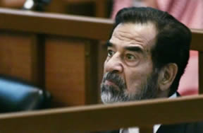 Iraq's former military strongman Saddam Hussein faces a likely death sentence on Sunday amid fears that the verdict could provoke violent reprisals from his Sunni Arab supporters.